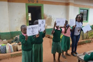 The Water Project: Kituluni Primary School -  Students Hold Training Materials