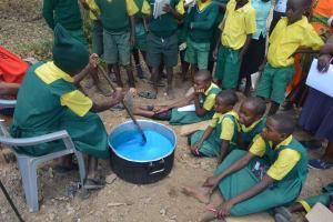 The Water Project: Kakunike Primary School -  Student Making Soap