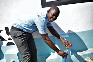 The Water Project: Kalulini Boys' Secondary School -  Fetching Water
