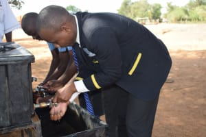 The Water Project: Kalulini Boys' Secondary School -  Students Use New Handwashing Station