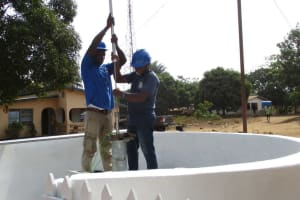 The Water Project: Tholmossor, Amputee Camp -  Installing Pump