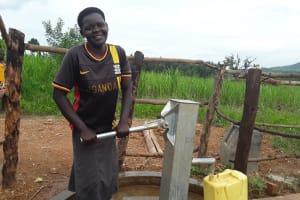 The Water Project: Kimigi Kyamatama Community -  Jane Fetching Water