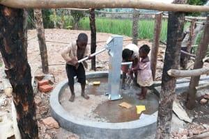 The Water Project: Kimigi Kyamatama Community -  Kids Fetching Water