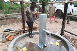 The Water Project: Kimigi Kyamatama Community -  Pumping The Well