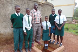 The Water Project: Kwirenyi Secondary School -  Students And Mr Muchesia At Rain Tank