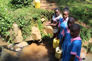 The Water Project: Irovo Orphanage Academy -  Team Leader Catherine Chepkemoi With Students At The Stream