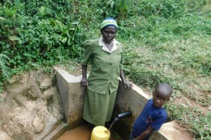 The Water Project: Maganyi Community, Bebei Spring -  Tabitha Left And Glorian Right