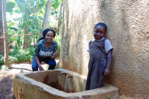 The Water Project: Mwanzo Primary School -  Field Officer Georgina With Noeline