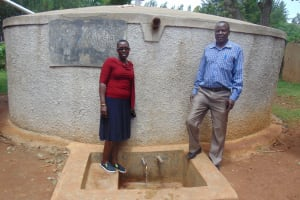 The Water Project: Namalasire Primary School -  Field Officer Janet Kayi With Head Teacher Mr Patrick Mango