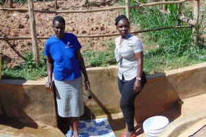 The Water Project: Bumavi Community, Esther Spring -  Field Officer Laura Alulu Right With Community Member