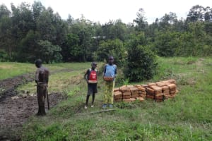 The Water Project: Eshikhugula Community, Shaban Opuka Spring -  Kids Help Deliver Materials