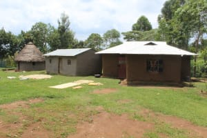 The Water Project: Kalenda B Community, Lumbasi Spring -  Typical Home Compound With Range Of Building Type