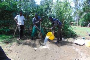 The Water Project: Buhayi Community, Nasichundukha Spring -  Mixing Cement