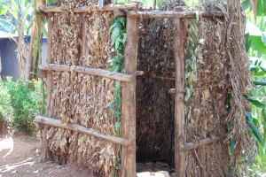 The Water Project: Kimarani Community, Kipsiro Spring -  Bathroom Made Of Banana Leaves