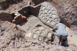 The Water Project: Shihingo Community, Inzuka Spring -  Stone Wall Construction