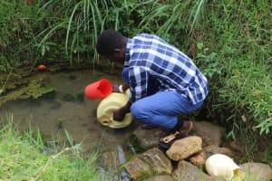 The Water Project: Kalenda B Community, Lumbasi Spring -  Fetching Water