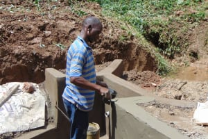 The Water Project: Shamiloli Community, Kwasasala Spring -  Cementing And Plastering