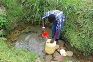 The Water Project: Kalenda B Community, Lumbasi Spring -  Filling Up