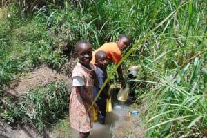 The Water Project: Bukhaywa Community, Shidero Spring -  Fetching Water