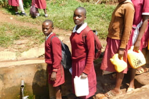 The Water Project: Ebukhuliti Primary School -  Students Line Up To Fetch Water At The Spring