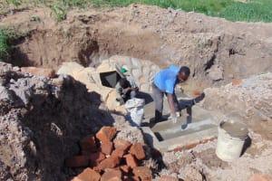 The Water Project: Shihingo Community, Inzuka Spring -  Plastering The Stairs