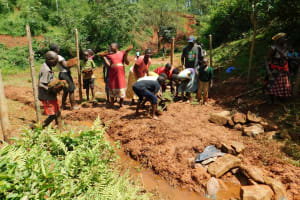 The Water Project: Mutao Community, Kenya Spring -  Grass Planting