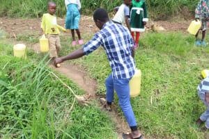 The Water Project: Kalenda B Community, Lumbasi Spring -  Carrying Water Home