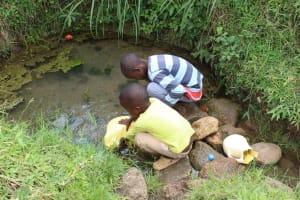 The Water Project: Kalenda B Community, Lumbasi Spring -  Children Fetch Water