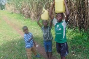The Water Project: Mukangu Community, Metah Spring -  Children Carrying Water