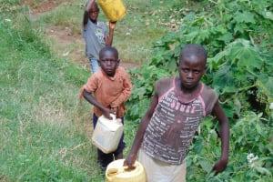 The Water Project: Kimarani Community, Kipsiro Spring -  Carrying Water Home