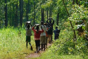 The Water Project: Mutao Community, Kenya Spring -  Children Carry Stones To The Spring