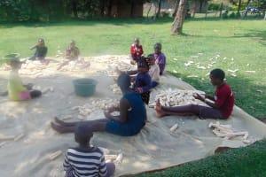 The Water Project: Mukangu Community, Metah Spring -  Children Shelling Maize