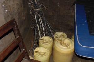 The Water Project: Kimarani Community, Kipsiro Spring -  Water Storage Containers