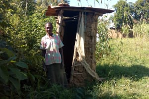 The Water Project: Sambaka Community, Sambaka Spring -  Woman With Latrine