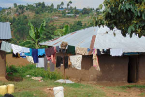 The Water Project: Kimarani Community, Kipsiro Spring -  Laundry Dries And Community Landscape