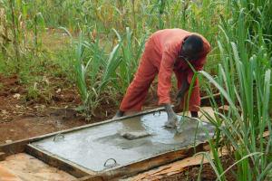 The Water Project: Mutao Community, Kenya Spring -  Slab Setting