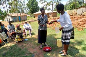 The Water Project: Shihingo Community, Inzuka Spring -  Handwashing Demonstration