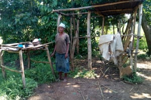 The Water Project: Sambaka Community, Sambaka Spring -  Woman Next To Dishrack