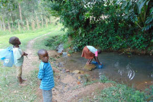 The Water Project: Bukhaywa Community, Ashikhanga Spring -  Fetching Water At The Spring