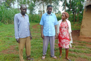 The Water Project: Namarambi Community, Iddi Spring -  Shaban Musa Left And Leonard Hassan Center
