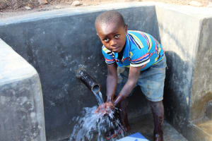 The Water Project: Eshikhugula Community, Shaban Opuka Spring -  Camera Shy