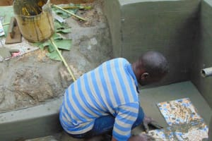 The Water Project: Shamiloli Community, Kwasasala Spring -  Tile Setting