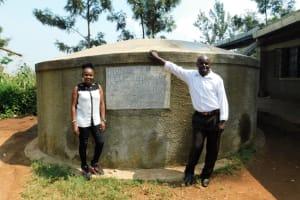 The Water Project: Shitsava Primary School -  Field Officer Georgina With Deputy Head Teacher Mr Casper Mumia