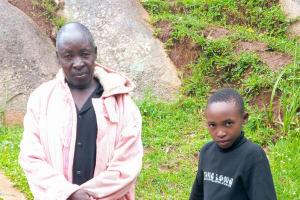 The Water Project: Chandolo Community, Joseph Ingara Spring -  Joseph Ingara With Stacy Vugutsa