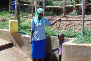 The Water Project: Bumavi Community, Esther Spring -  Eunice Shibale With Justin Mbone