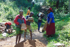 The Water Project: Shamiloli Community, Kwasasala Spring -  Children Deliver Sand For Construction
