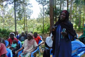The Water Project: Buhayi Community, Nasichundukha Spring -  Community Member Responds To A Question