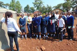 The Water Project: Ikumba Secondary School -  Explaining Tank Maintenance