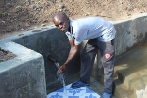 The Water Project: Eshikhugula Community, Shaban Opuka Spring -  Flowing Water
