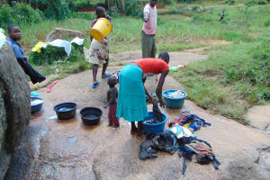 The Water Project: Munenga Community, Francis Were Spring -  Doing Laundry At The River